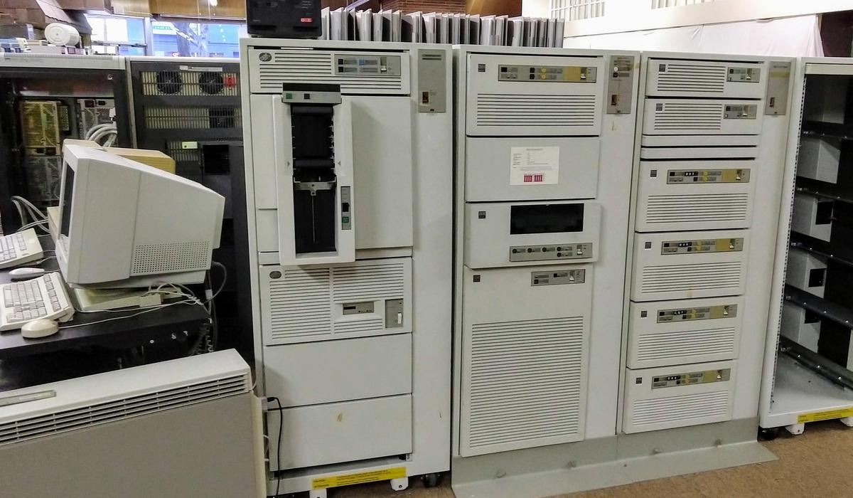 IBM System/370 9375. The computer itself is in the middle rack. The left rack has a 3490E tape cartridge storage system, while the right rack holds 9335 disk controllers and disk drives (856 MB per drive).