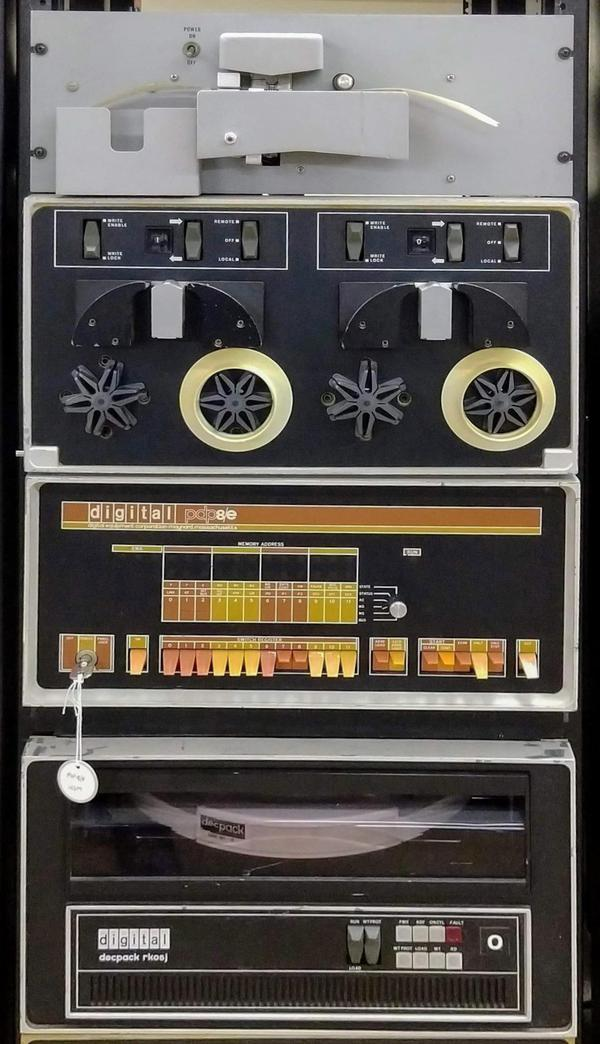 PDP-8/E minicomputer. The paper tape reader is at the top, above the front panel. An RK05 DECpack is at the bottom, storing 2.4 megabytes on a removable disk pack.