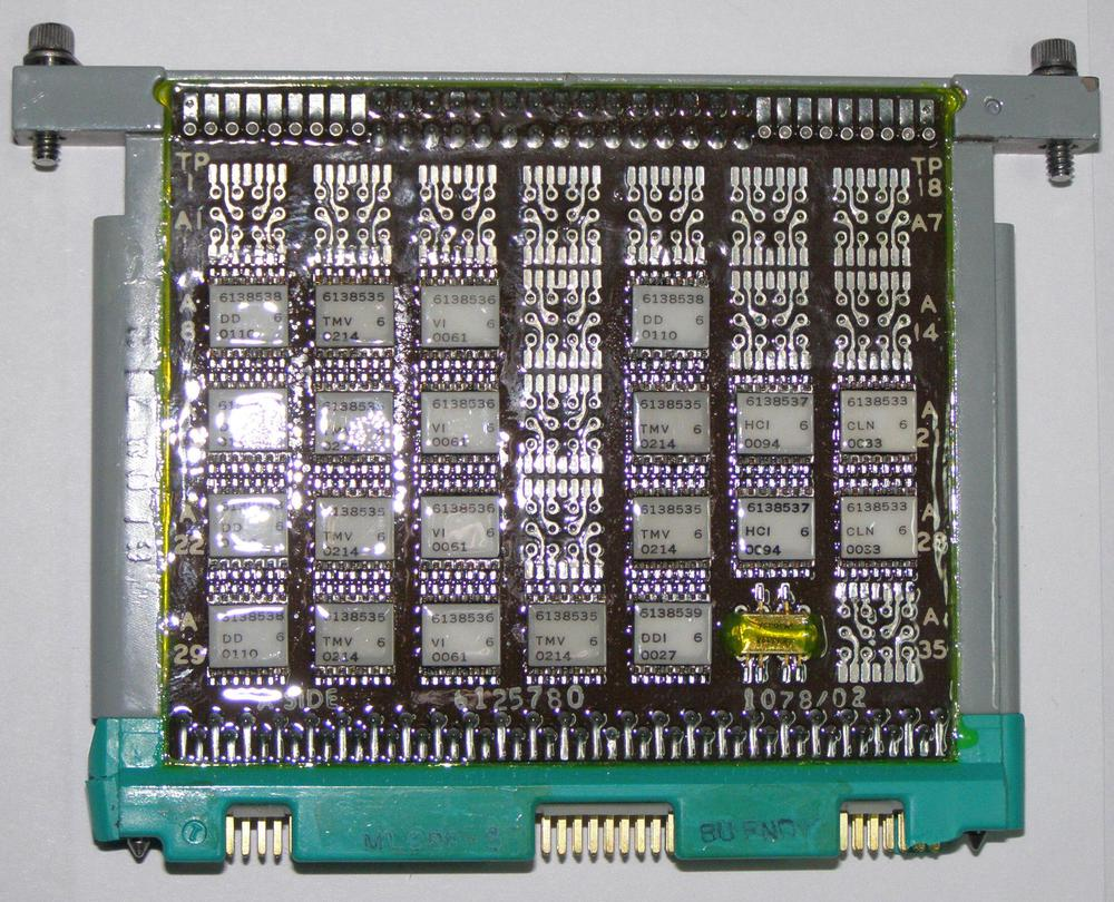 A page including the metal frame. This board implemented voting circuitry in the LDVC. Photo from Dmitris Vitoris via Virtual AGC.