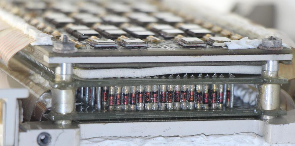 Closeup of X diode matrix showing diodes mounted vertically using cordwood construction between two printed circuit boards. The two X driver boards are above the diode board, separated from it by foam. Note how the circuit boards are packed very closely together.