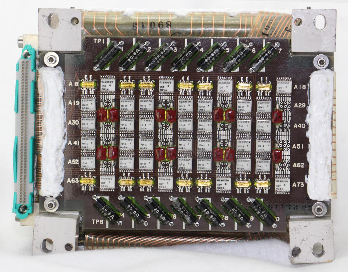 The inhibit board on the bottom of the memory module. This board generates the 14 inhibit signals used during writing.