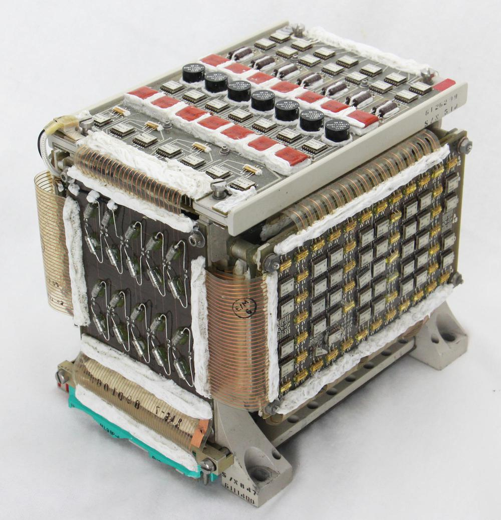"A core memory module from the LVDC. This module stored 4K words of 26 data bits and 2 parity bits. It weighs 2.3 kg (5.1 pounds) and measures about 14 cm×14 cm×16 cm (5½""×5½""×6""). Click on any photo for a larger version."