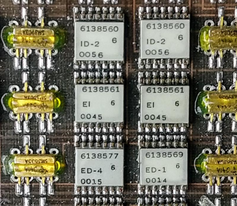 "Closeup of the Y driver board showing six ULD modules and six transistor pairs. Each ULD module is labeled with an IBM part number, the module type (e.g. ""EI""), and an unknown code."