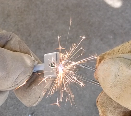 Shorting a cheap charger with a paperclip creates impressive sparks.