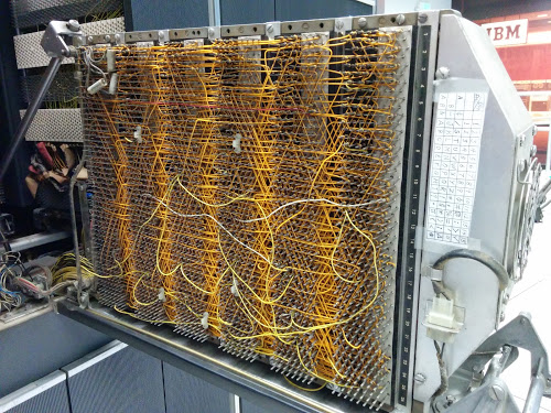 A maze of wire-wrapped wires connects the circuits of the IBM 1401 computer.