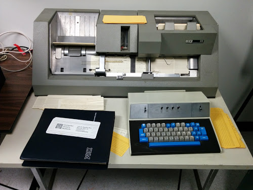 An IBM 029 keypunch preparing a card deck that generates the Mandelbrot fractal.
