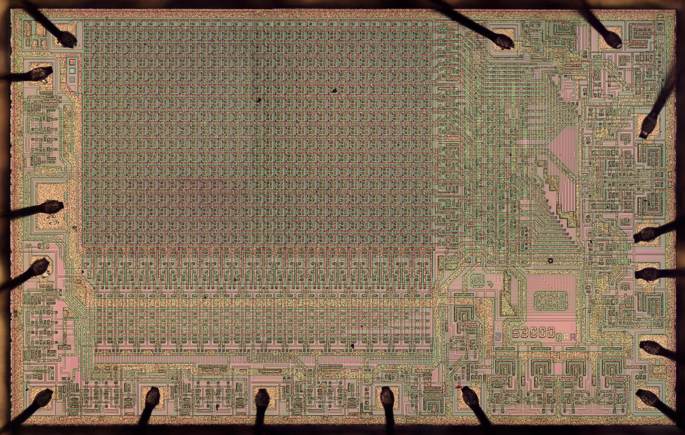 Die of the MMI 5300 PROM chip, holding 1024 bits of information. Click image for a larger version.