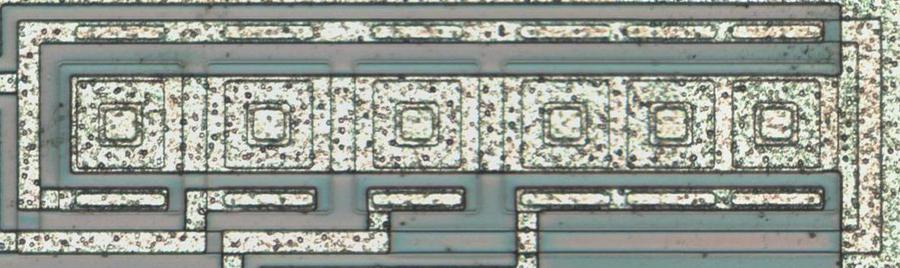 Six transistors form a current mirror in the chip.