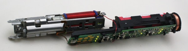 The brush mechanism (left) separated from the electronics (right). Note the illuminated LEDs. Alto note the flexible brown ribbon connecting the pressure sensor to the electronics board.