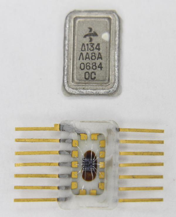 The integrated circuit with its metal lid removed, showing the tiny silicon die inside.