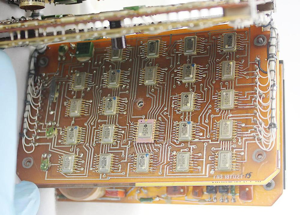 Board 3 is filled with digital logic integrated circuits. Pins on either side connect the board to the wiring harnesses.