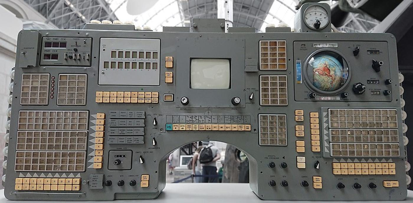 Control panel from a Soyuz spacecraft. The digital clock is in the upper left of the panel. The screen in the middle is a TV monitor. Photo from Stanislav Kozlovskiy, CC BY-SA 4.0.