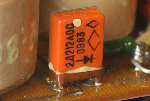 "The power supply uses 1 amp diodes in rectangular orange packages. The ""OC"" indicates a higher-quality military part."