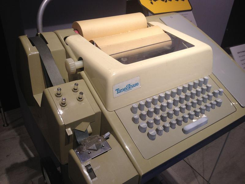 A Teletype ASR33 communicated in ASCII and printed 72 characters per line. Hundreds of thousands of these were produced from 1963 to 1981. The punched tape reader and punch is on the left. Photo from Arnold Reinhold, (CC BY-SA 3.0).