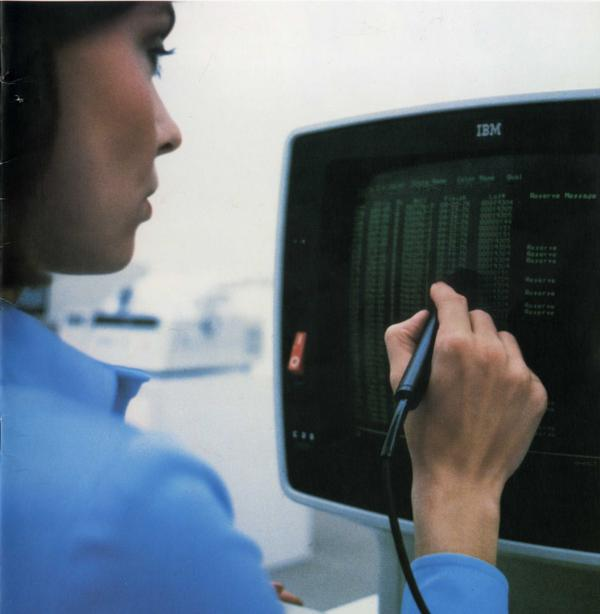 The IBM 3270 terminal. The Selector Light Pen was used to select data fields, somewhat like a mouse. This terminal is a later model, the 3278; in the photo it is displaying 43 lines of 80 characters. From IBM 3270 Brochure (1977).
