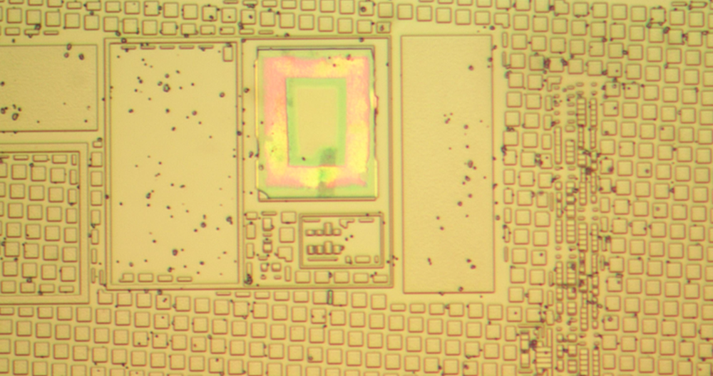 The secondary silicon die, showing CMP fill surrounding some circuitry.