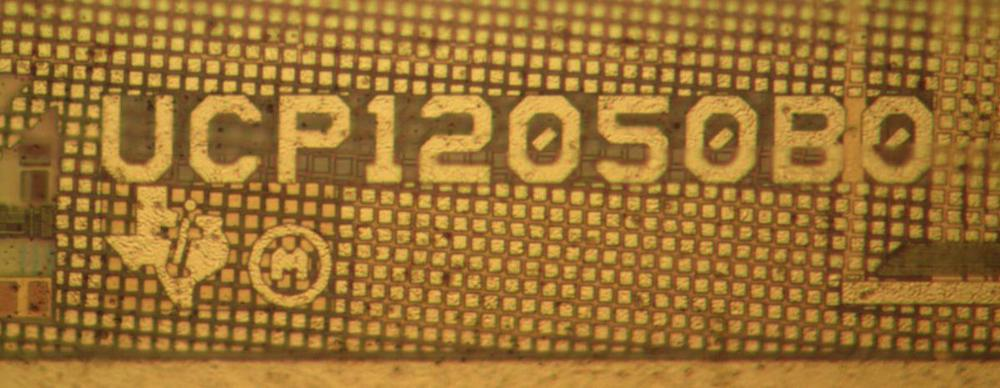 "The logo on the primary die, surrounded by CMP fill. The ""P"" in ""UCP"" indicates the primary."