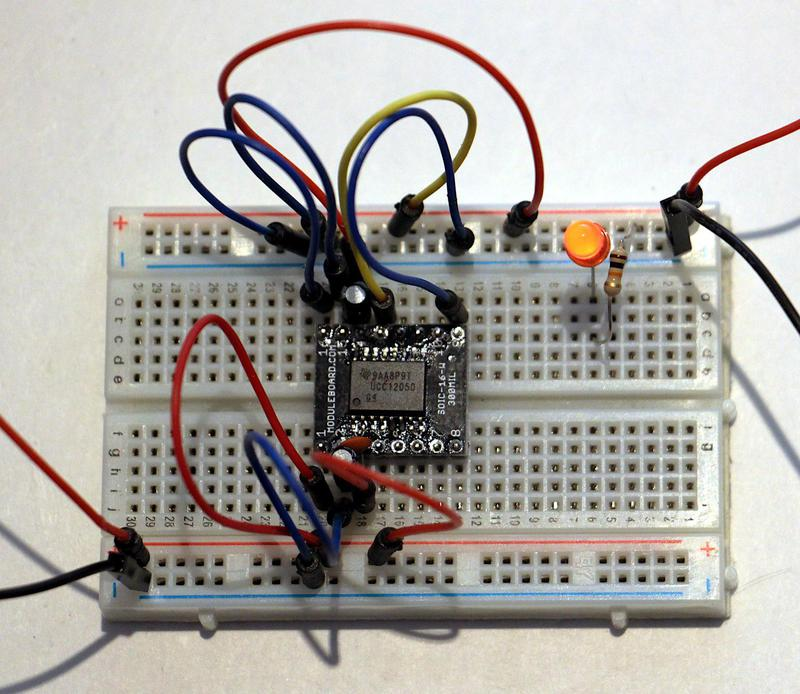 The chip wired up on a breadboard. The chip is mounted on the breakout board in the middle, which allows it to be plugged into the breadboard.