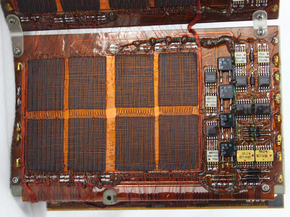 "One plane in the core memory has 16,384 cores. It consists of eight smaller regions (""mats""); each mat has 32×64 cores."