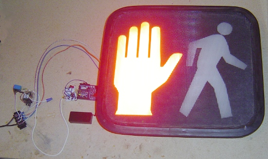 A pedestrian sign controlled by an Arduino.