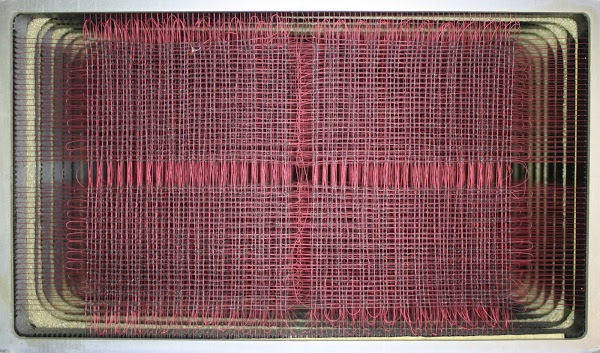 Core memory in the IBM 1401 mainframe. Each layer (plane) has 4,000 tiny cores in an 80x50 grid. Multiple planes are stacked to form the memory.