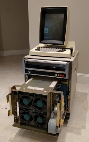 The Xerox Alto II XM 'personal computer'. The card cage below the disk drive has been partially removed. Four cooling fans are visible at the front of it.