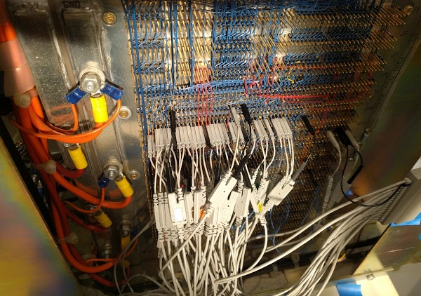 The backplane of the Xerox Alto, with probes from the logic analyzer attached to trace microcode execution. Note the thick power wires on the left.