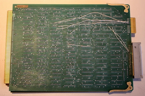 This is the Xerox Alto control board, one of three boards that make up the CPU. The board has been modified with several white wires.