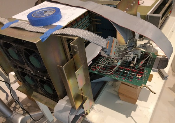 Logic analyzer hooked up to the Xerox Alto. By plugging the control board into an extension board, probes can be attached to it.