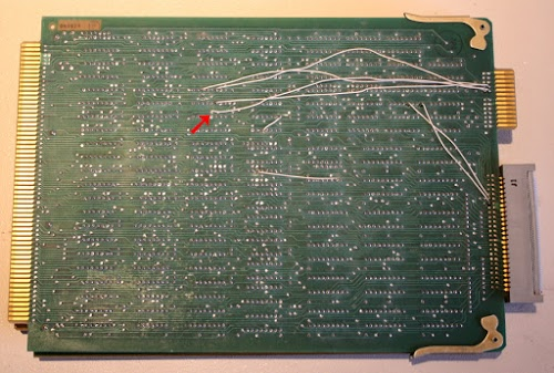 Control board from the Xerox Alto, showing a broken wire. The white wires were for a modification, but one wire came loose.