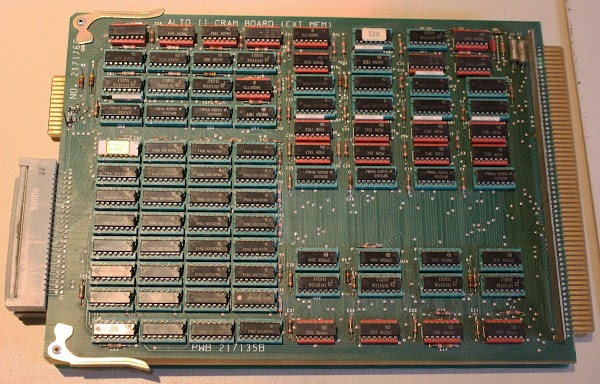 The Xerox Alto's CRAM board (Control RAM) stores 1024 microcode instructions. The 32 memory chips in the lower left provide the 1024x32 storage.