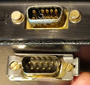 The Alto's mouse plugs into the 19-pin connector on the keyboard housing (above). Unfortunately our mouse has a 9-pin connector (below).