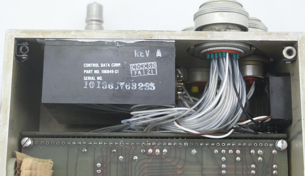 The power supply components are sealed in black plastic.