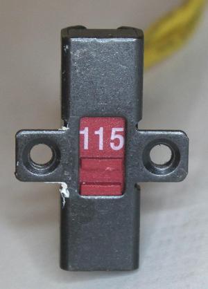 The 115/230 V switch.