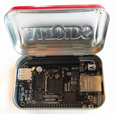 The BeagleBone Black single-board computer inside an Altoids mint tin.