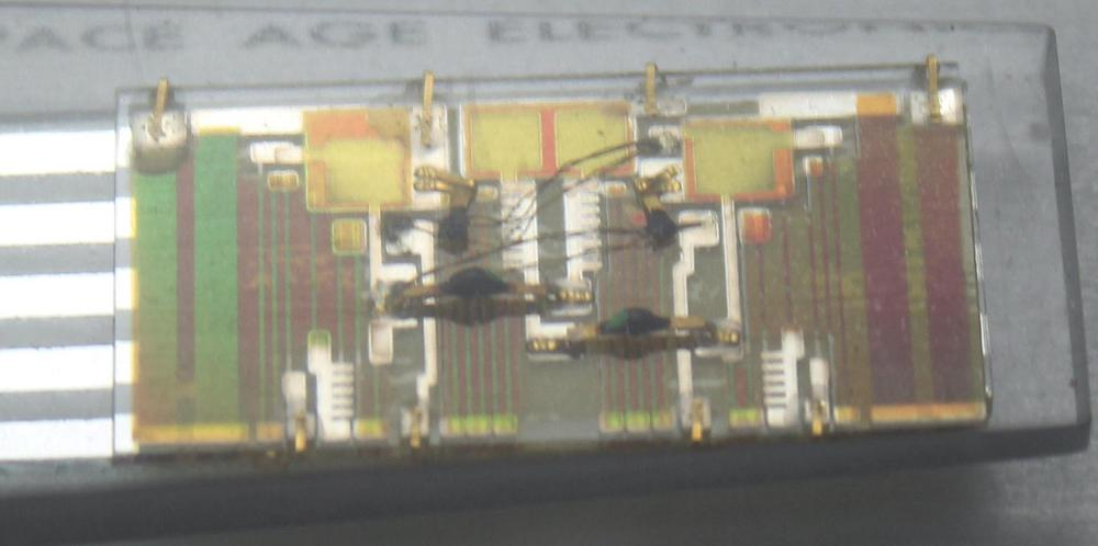 This angle view shows how the semiconductor components are mounted above the thin film circuitry.