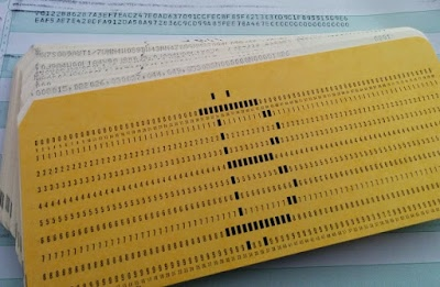 The Bitcoin symbol on an IBM punched card.
