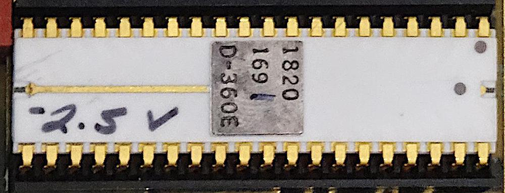 "The HP Nanoprocessor, part number 1820-1691. Note the hand-written bias voltage ""-2.5 V"", which varies from chip to chip. The last digit (1) of the part number is also hand-written, indicating the speed of the chip. Photo courtesy of Marc Verdiell."