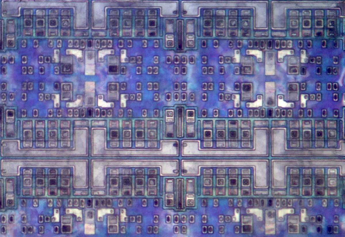 Closeup of the logic cells. I stacked multiple photos after removing the metal layers to get this image.