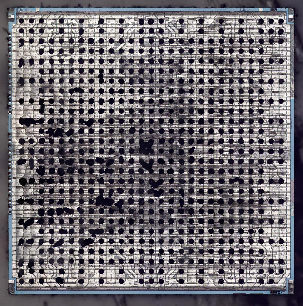Die photo of a bipolar logic chip, showing the solder balls. (Click for a larger version.)