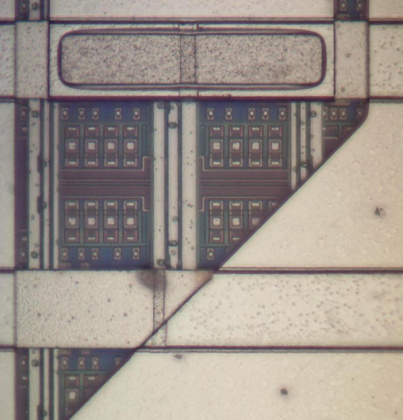 Detail of a bipolar logic chip from the ES/9000 computer. This closeup of the die shows the four layers of metal and the transistors underneath. Click this photo (or any other) for a larger version.