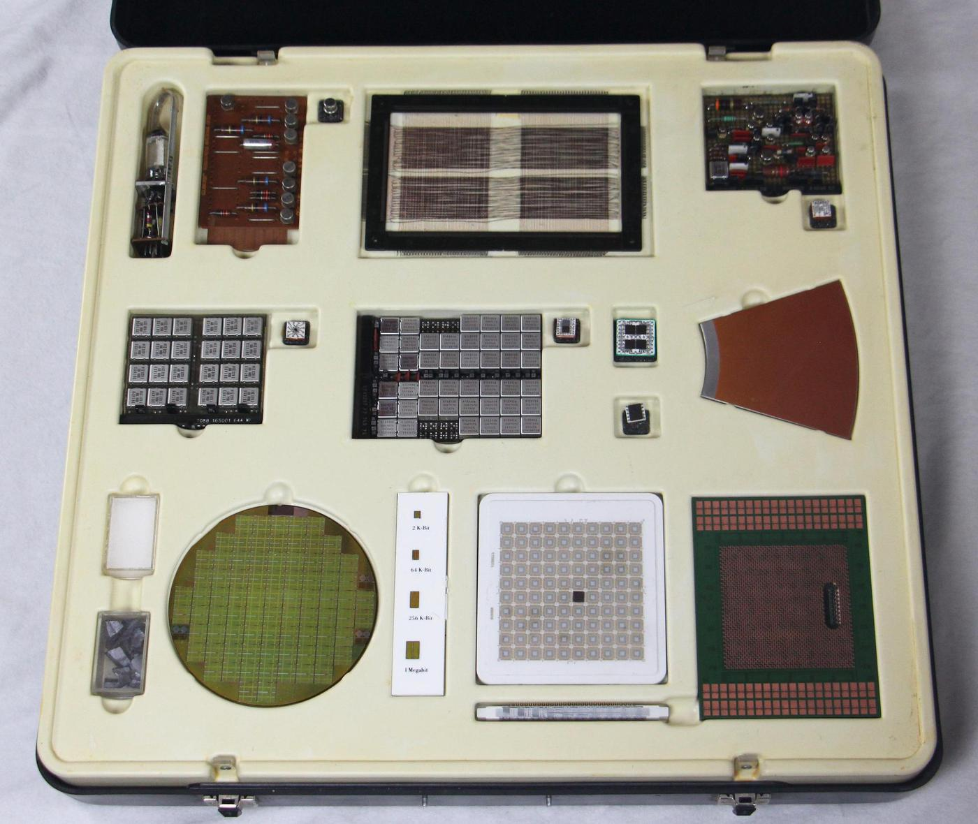 An IBM display box, showing components and board from different generations of computing. Click this (or any other photo) for a larger image.