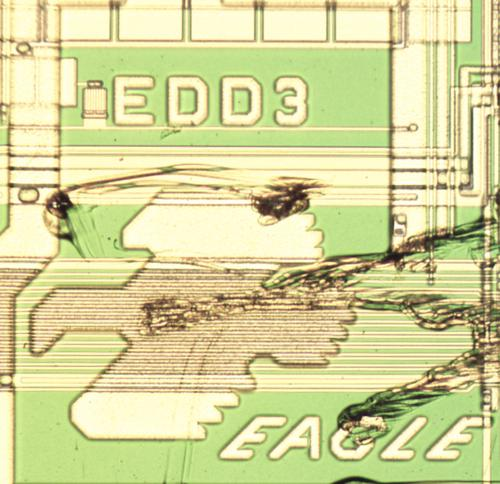 The eagle chip art on the 1-megabit RAM chip, slightly scratched.