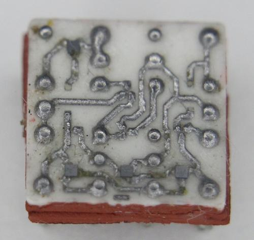 Closeup of an SLT module showing the tiny silicon dies mounted on the ceramic substrate.