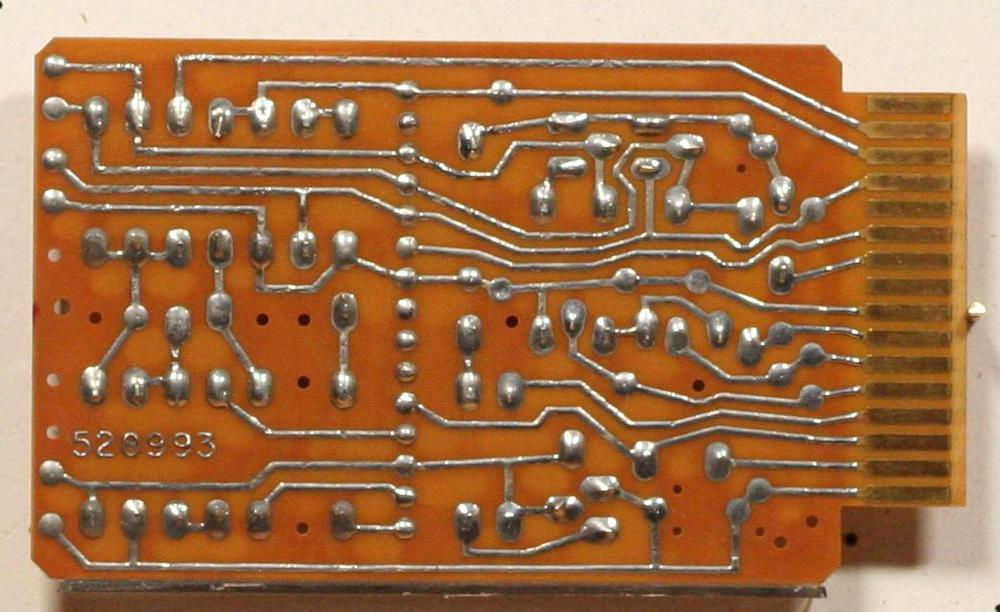 The back of the card has the PCB traces and the gold-plated edge connector.