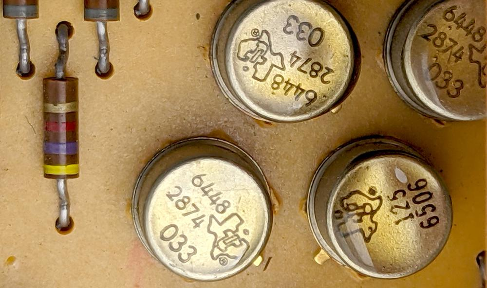 Closeup of the Texas Instruments transistors. Most of the transistors on the board were PNP type 033.