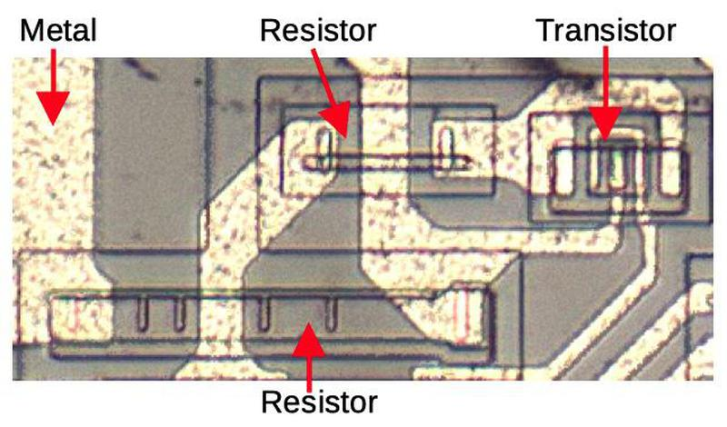 Two resistors and a transistor as they appear on the die.