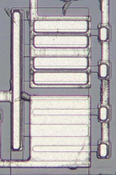 Transistors and omitted transistors. The upper rectangular block consists of transistors, while the lower rectangular block has no function.