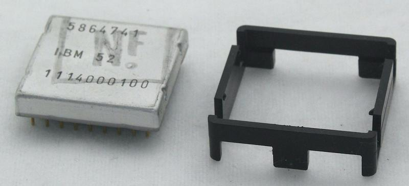 The integrated circuit with the metal package, part number 5864741. The black clip next to the package holds the die, but I don't know if this was for shipping or during use.