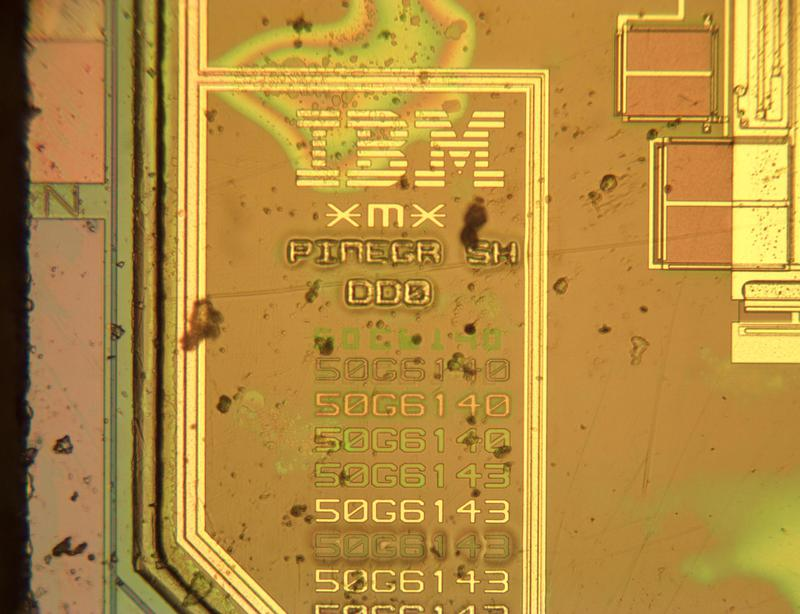 "The IBM logo is in the lower-left corner of the die, along with the mysterious codename ""PINEGR SH""."